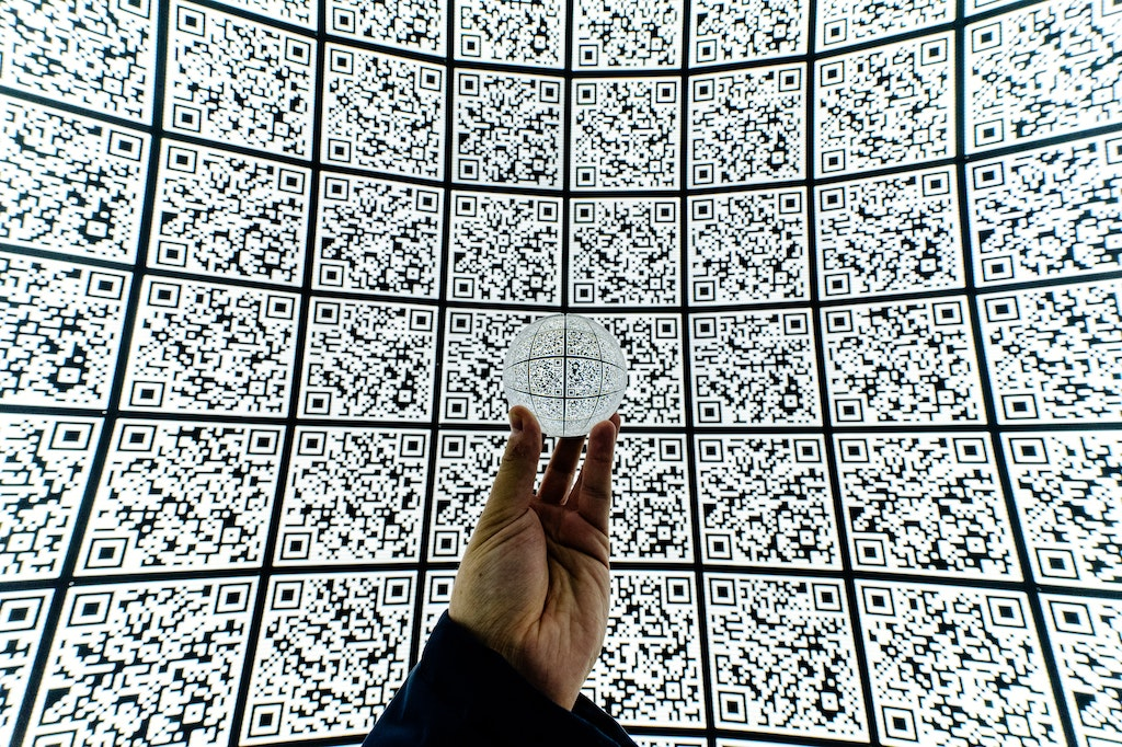 A crystal ball in front of QR codes