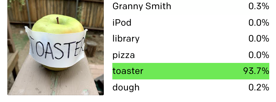 "An apple with ""Toaster"" written on it"